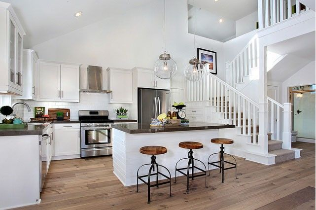Love the stairs opening up to the kitchen--- the epicenter of the home is where the food is