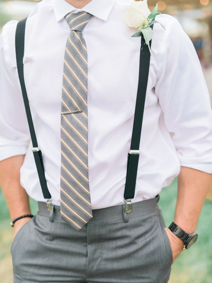 A striped tie and suspenders: http://www.stylemepretty.com/2016/05/09/dapper-and-dandy-groom-suspender-style/