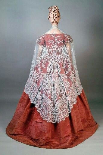 1850s moiré silk taffeta dress & Brussels lace shawl. From Kent State Univ Museum