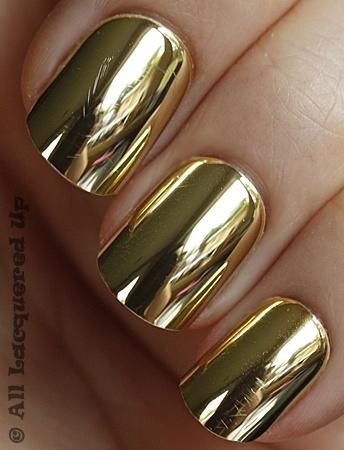 Gold chrome nail polish.