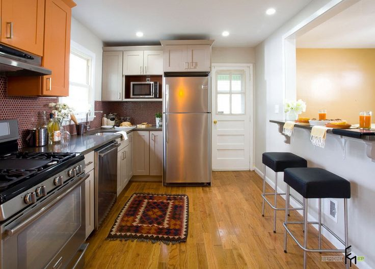 Lovely A Cool Kitchen Hallway With Laminate Flooring And Brown Wooden Floating  Cabinet Also Silvery Appliances Plus Part 11