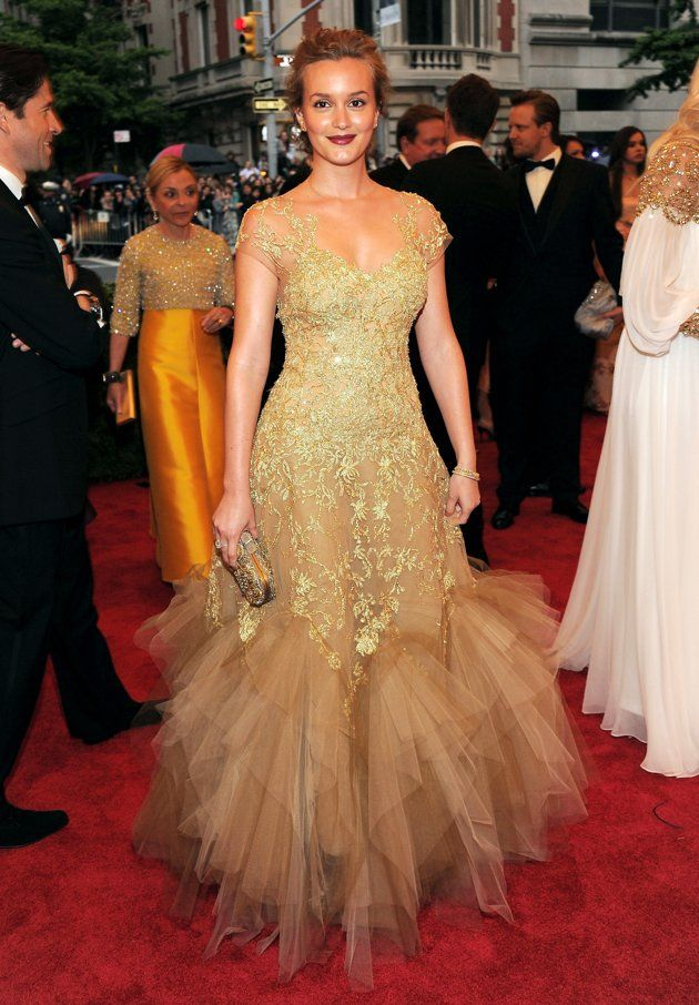 """Gossip Girl"" star Leighton Meester was a bronzed beauty in a gold Marchesa dress with a lace bodice and poufy tulle skirt."