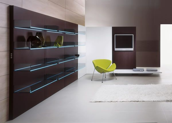 'Lighterie' Elegant finishes combined with the magic of the lit glass for this multi-functional bookcase/display unit with shelves that are crossed by a shaft of light. Available in three different finishes: wengè, bleached oak and aluminium laminate. And with three options: with four shelves, with two shelves and office desk, with two shelves and TV unit mounted on castors.
