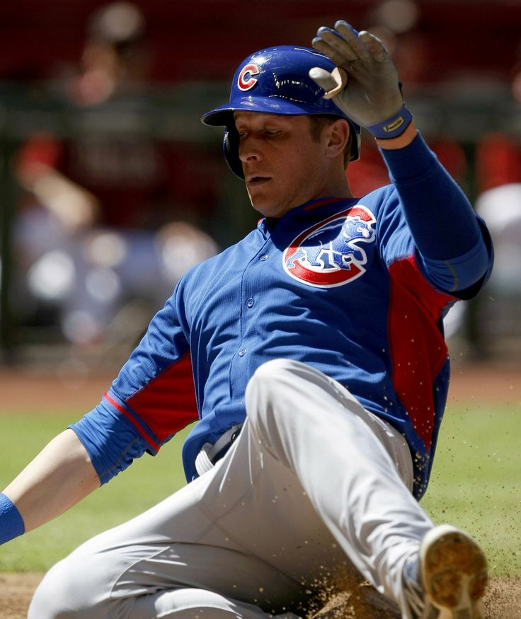 Chicago Cubs center fielder Ryan Sweeney (6) scores in the third inning against the Arizona Diamondbacks at Chase Field.