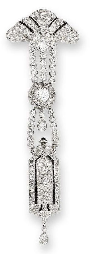 An art deco onyx and diamond lapel watch, circa 1925