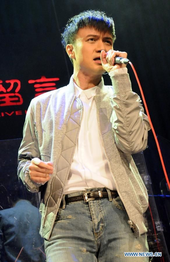 "Singer Leo Ku sings during a concert for his new album ""We"" in Taipei, Taiwan, July 10, 2015  http://www.chinaentertainmentnews.com/2015/07/leo-ku-stages-concert-for-album-we-in.html"