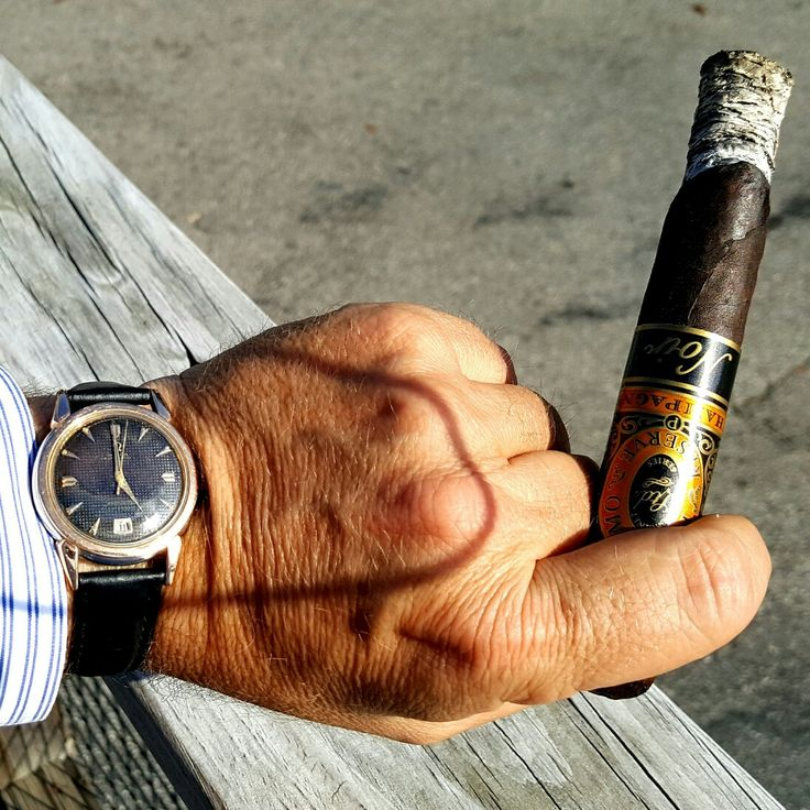 Enjoying a Perdomo Chapagne Noir and my dad's old Omega Seamaster.  #watches #watchcommunity #watchporn #horology #watchesofinstagram #wristcandy #wristwatch #wristwatchcheck #wristwatches #watchaddict #watchcommunity #watchgeek #watchgeeks #automaticwatch #menswatch #mechanicalwatch #cigars
