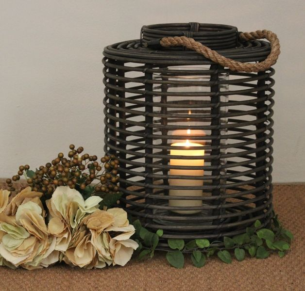 Blackish Lantern.  With a thick rope handle and a glass insert to protect the candle, this lantern is sure to bring ambiance to any room of the home.