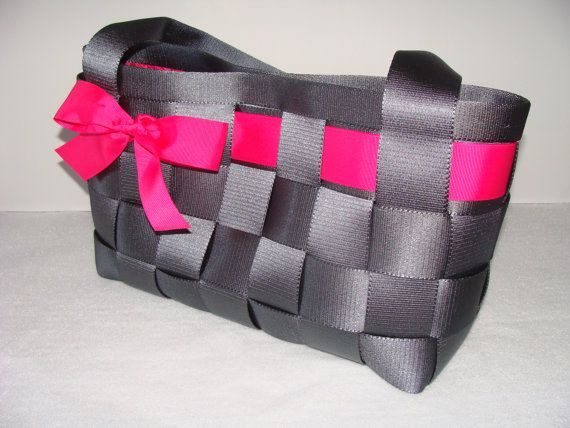 Grey seatbelt purse with bright pink patterned lining -- love the pop of color within the grey