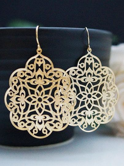 I like gold on earrings. That way it sort of looks like a maze and a compass in the middle.: