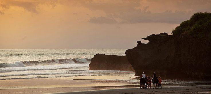 Horse-riding along the black sand coastline.