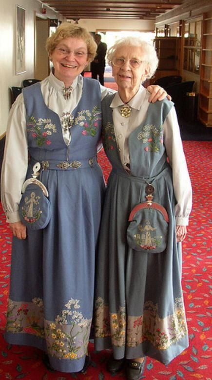 The official Oslo bunad with delicate flowers embroidered on costume. On purse is St. Hallvard the guardian angel of Oslo.