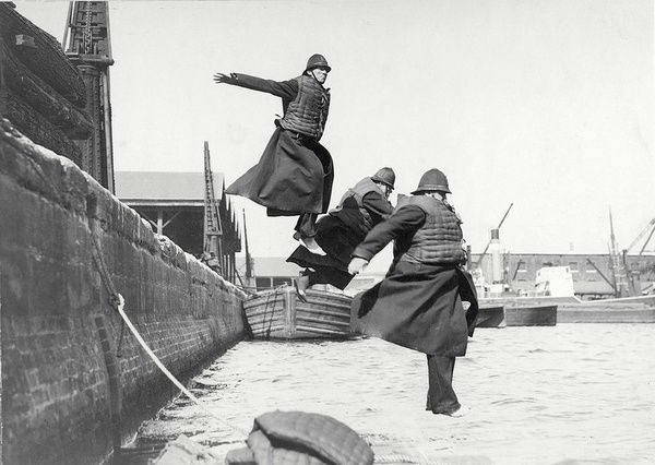 A jump into the Thames - training for policemen, 1920 (London)