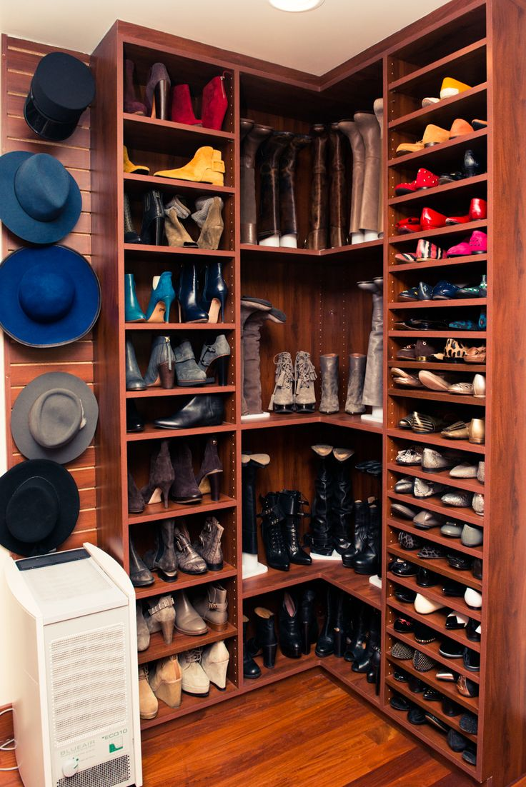 Jessica Alba's shoe organized shoe closet. Winning combo of space for shoes and boots, not to mention the hats hung on hooks.
