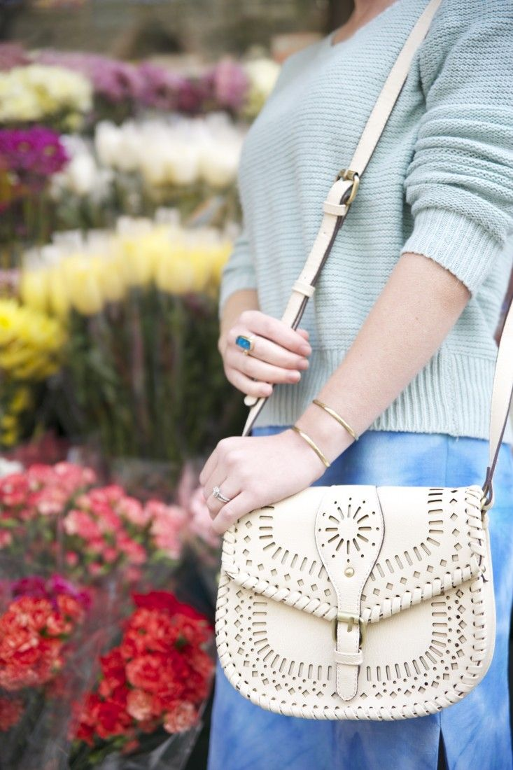 Cross-body saddle bag with intricate laser cut detailing and a structured shape!