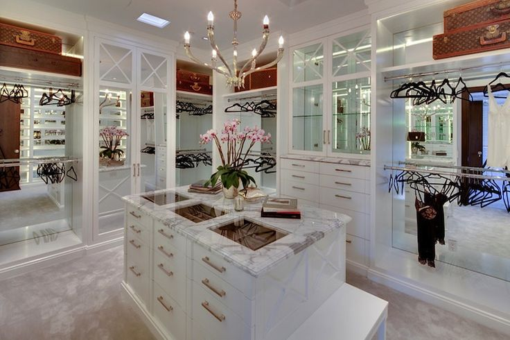 Gordon Gibson Construction - stunning closet design with calcutta marble-top closet island