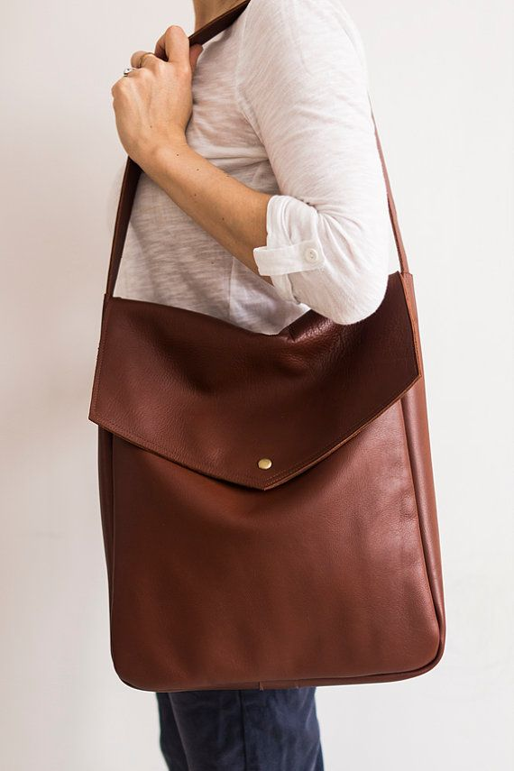 A large bag on shoulder and hand. Made of strong brown leather. Inside without lining with one pocket, 20 x 20 cm (8 x 8). Close with snap. Dimensions: height: 35 cm, 13,8 width 31 cm, 12,2 depth 10 cm, 4 ear length about 68 cm, 27. Fits A4.  Ready to shipp!!! Standard delivery time:  European union: 4 - 10 days  Europe (not EU): 7 - 14 days  U.S.A., Canada: 10 - 20 days  Australia, South America, Asia, India, North Africa: 1 - 3 weeks  We send all items with priority air mail and tracking…