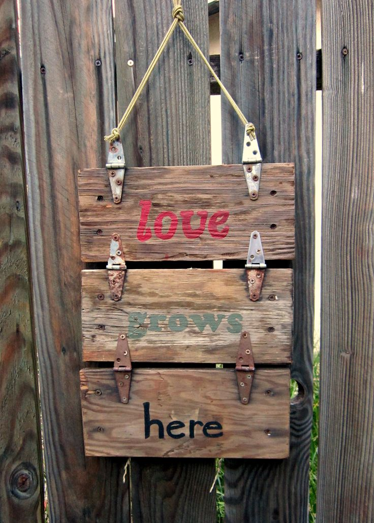 Garden sign I made with lids from rustic re- purposed wooden machine tool boxes. I love the rusty hinges.