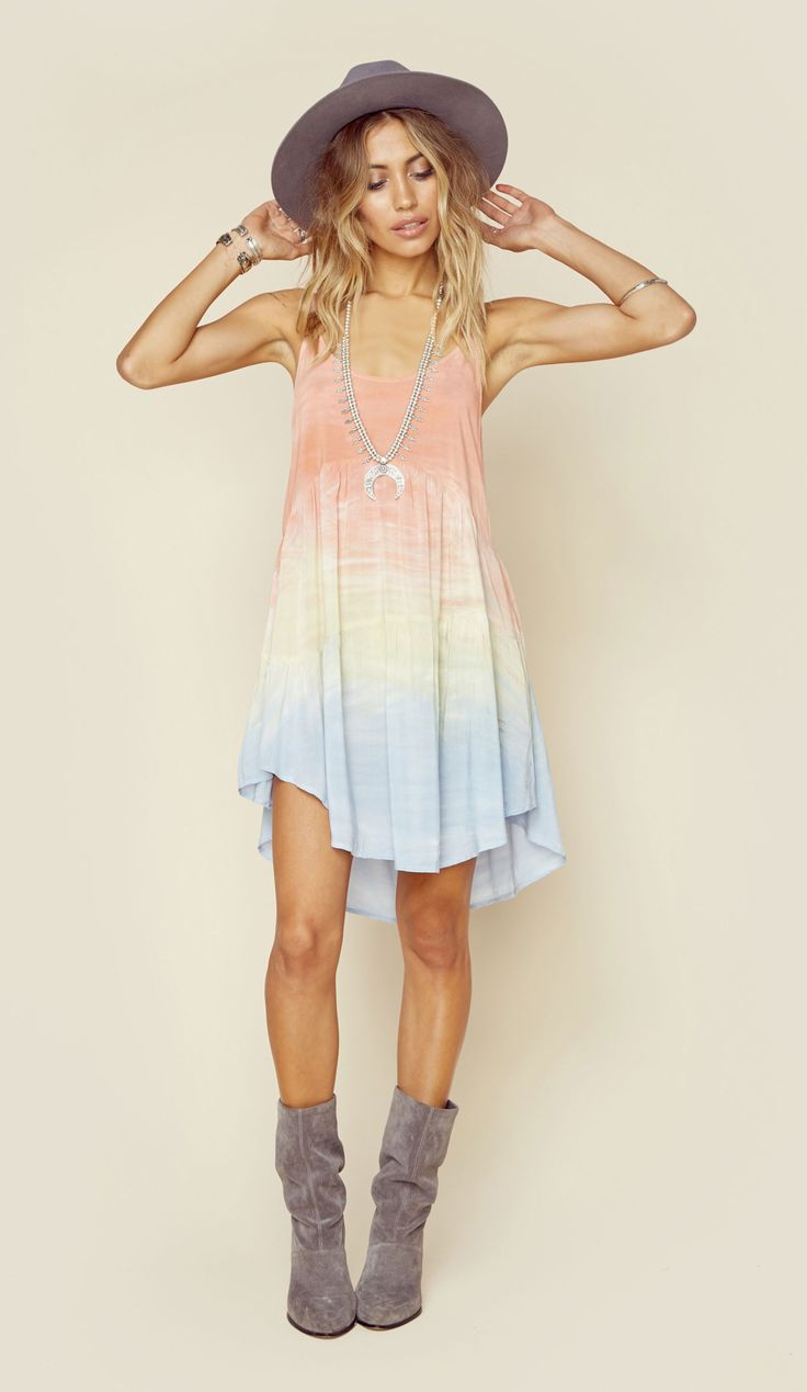 This stunning multi-color tie dye desert dancer dress by Blue Life features hand dyed rayon fabric for a lightweight and flowy fit. You'll love the lace up detailing in back and slightly ruffled floun