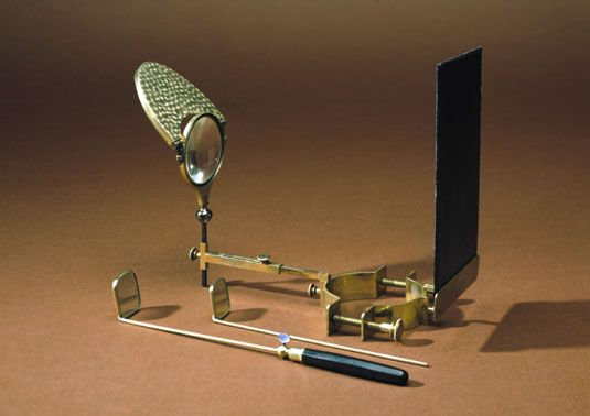 """The laryngoscope is an instrument used for examining the throat and larynx. Invented in the 19th century, it was one of the first endoscopes (medical instruments for examining the interior of the body) to be developed. This example was made by Henry Galante of Paris, and was designed to be mounted on the chimney of an oil lamp."""