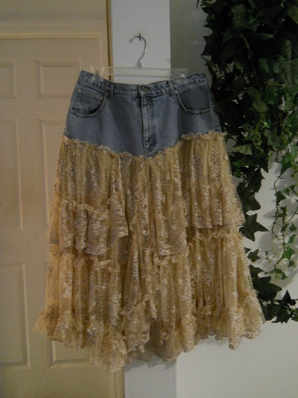 Upcycled skirt from vintage jeans, vintage lace, and silk lining. (For inspiration.) Click to see lots more great designs from this etsy seller! Belle Bohémienne jean skirt exquisite vintage lace ruffled tiered frou frou bohemian ballroom Renaissance Denim Couture. 150 dollars, via Etsy.