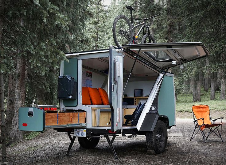 the tigermoth camping trailer is a versatile mobile home that makes living off-the-grid a reality, with running water, a pull-out kitchen, and optional solar panels.