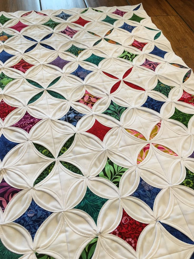I'm not sure if this cathedral window wall hanging actually counts as a quilt, since it has no batting, but I'm going to go ahead and call it one. I'd been seeing cathedral window…