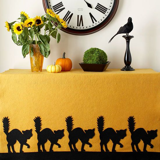 Get the cat pattern for this easy-to-make tablecloth: http://www.bhg.com/halloween/indoor-decorating/halloween-decorations/?socsrc=bhgpin092814cattrimmedtablecloth&page=7