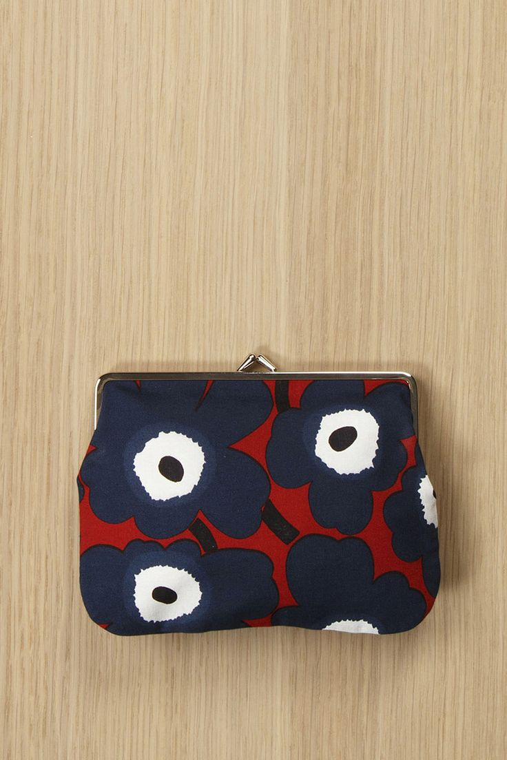 """Collection: Fall 2016 Bags. Print: Maija & Kristina Isola 1964/2009. Material: 100% woven cotton, lined in cotton. Metal clasp. Description: Long, narrow change purse in the iconic Unikko (""""poppy"""") pr"""