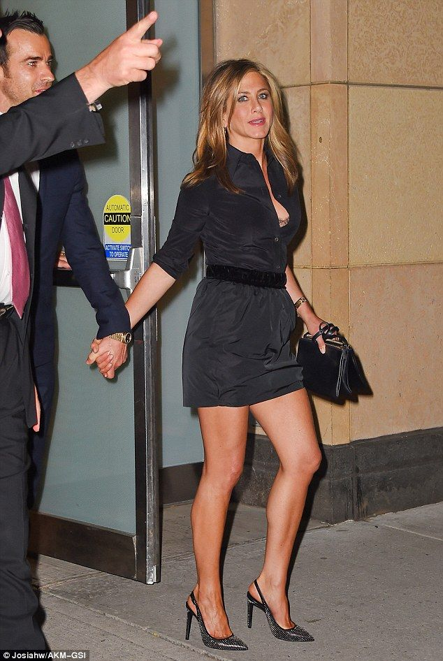Revealing: Jennifer flashes a touch of her grey bra thanks to her unbuttoned shirt dress