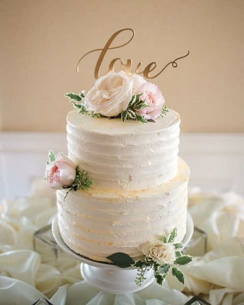 """Classic wedding cake idea - buttercream-frosted wedding cake - two-tier, white, buttercream-frosted wedding cake with blush roses + gold """"love"""" laser-cut cake topper {Fritz Photography}"""