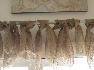 I have had many people ask about one of our window treatments in our shop its super easy and only 5 dollars.....You can get a very wide burlap ribbon at Michaels in the wedding/bridal aisle.  I think its $4.99 or $5.99. Then on a rod....you just cut a piece of the ribbon and tie it in a knot.  Then you continue to cut pieces until you have covered the rod.  I didnt even use the whole bolt of ribbon.