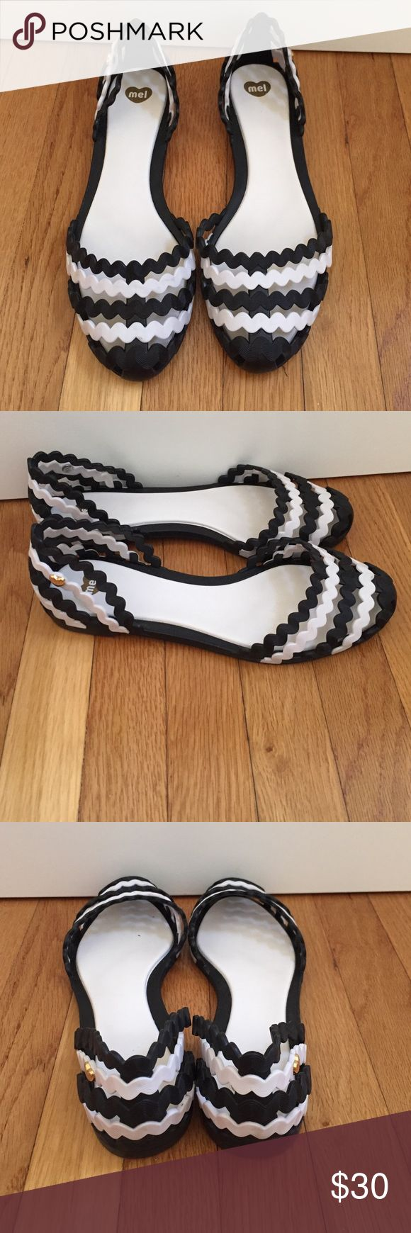 Mel by Mellisa flats These are cute, comfy flats that let your feet breathe for the summer time! They are stripped black and white. You can wear them to work, or for just a casual stroll. Will be shipped with the original box as they were never worn. Shoes Flats & Loafers