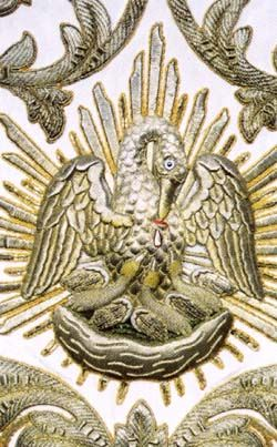 The pelican feeding its young with its own blood. Detail of a cope of 1855. This image symbolizes the Eucharist. Leiden, Hartebrugkerk.