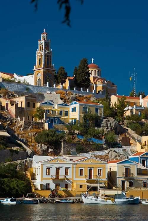 Symi also transliterated Syme or Simi is a Greek island and municipality. It is mountainous and includes the harbor town of Symi and its adjacent upper town Ano Symi, as well as several smaller loc...