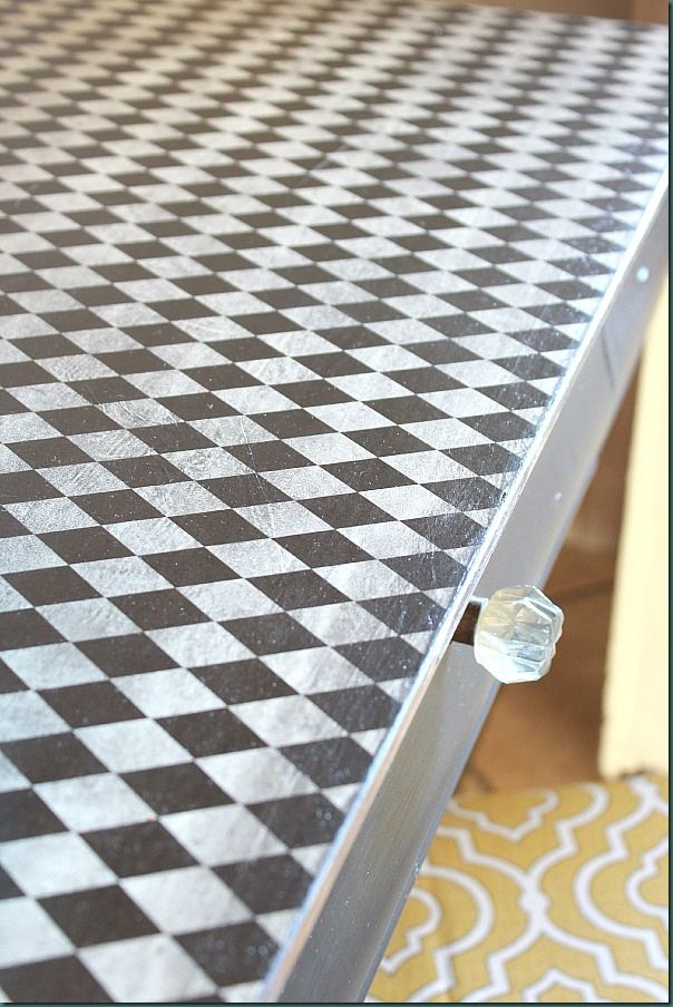 Mod Podge wrapping paper instead of painting the top of a desk!