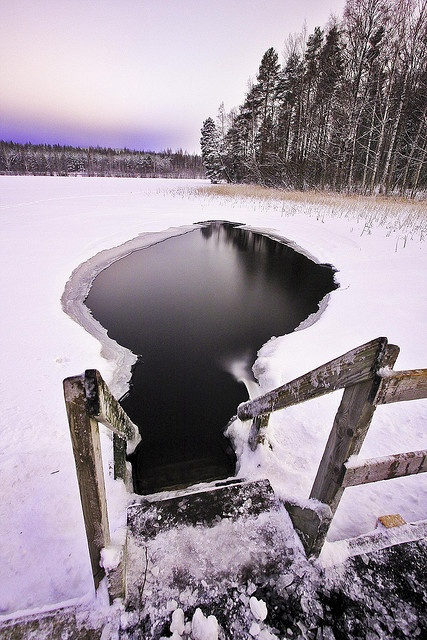 Ice swimming in Finland - great after a sauna or a roll in the snow.