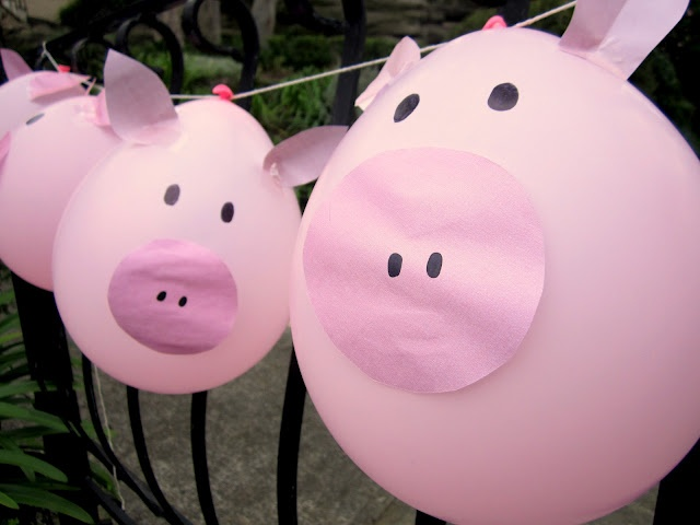 Piggy balloons for a farm party - you could easily do other animals as well. They make a great welcome at the front gate!