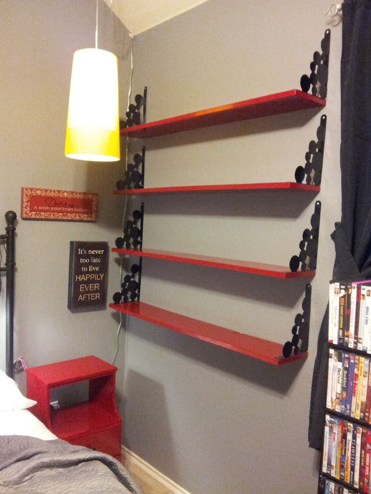 Brackets from Ikea.  Wood cut to length at Home Depot.  Gel paint.  Shelves for my DVDs (the brackets serve as bookends to hold up the DVDs since I hung the shelves upside down).