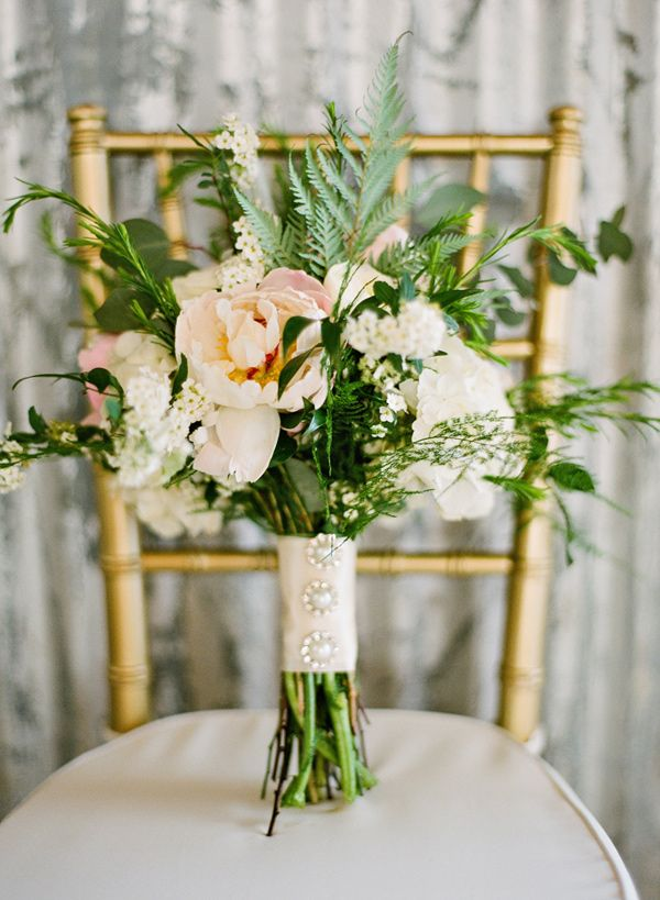 bouquet with leafy greenery - photo by Brandi Smyth http://ruffledblog.com/industrial-wedding-in-shreveport #weddingbouquet #bouquets