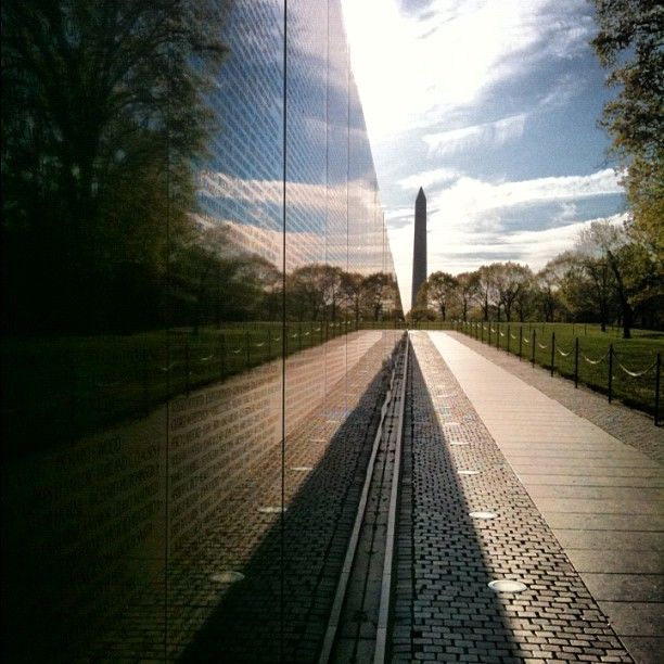 "Vietnam Veteran's Wall - Simply known as ""The Wall,"" this Memorial contains the names of the 58,256 veterans who were either killed in action or were still unaccounted for at the end of the Vietnam War."