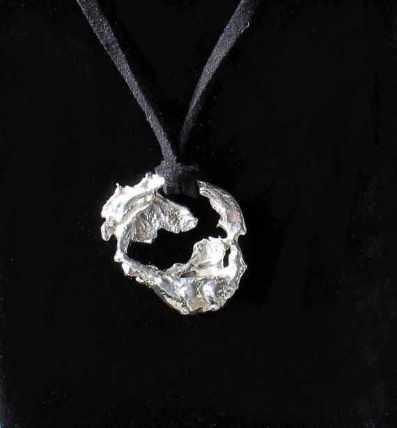 Made from recycled sterling silver this pendant is cast in water giving it a truly one of a kind, organic look and feel.