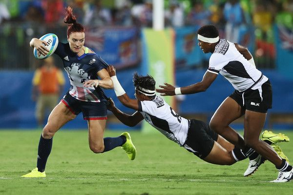 Joanne Watmore of Great Britain carries the ball under pressure from Lavenia Tinai of Fiji during the Women's Quarterfinal rugby match on Day 2 of the Rio 2016 Olympic Games at Deodoro Stadium on August 7, 2016 in Rio de Janeiro, Brazil.