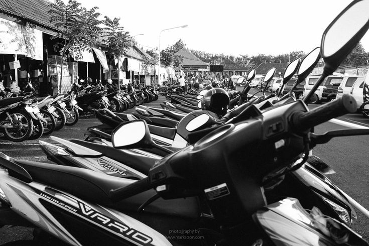 Hundreds upon hundreds of scooters line the parking lot in Uluwatu, Bali.
