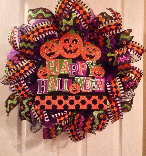 Happy Halloween mesh wreath! This wreath is ready to be shipped. It measures approximately 24x24. The sign in the center is made of wood and it