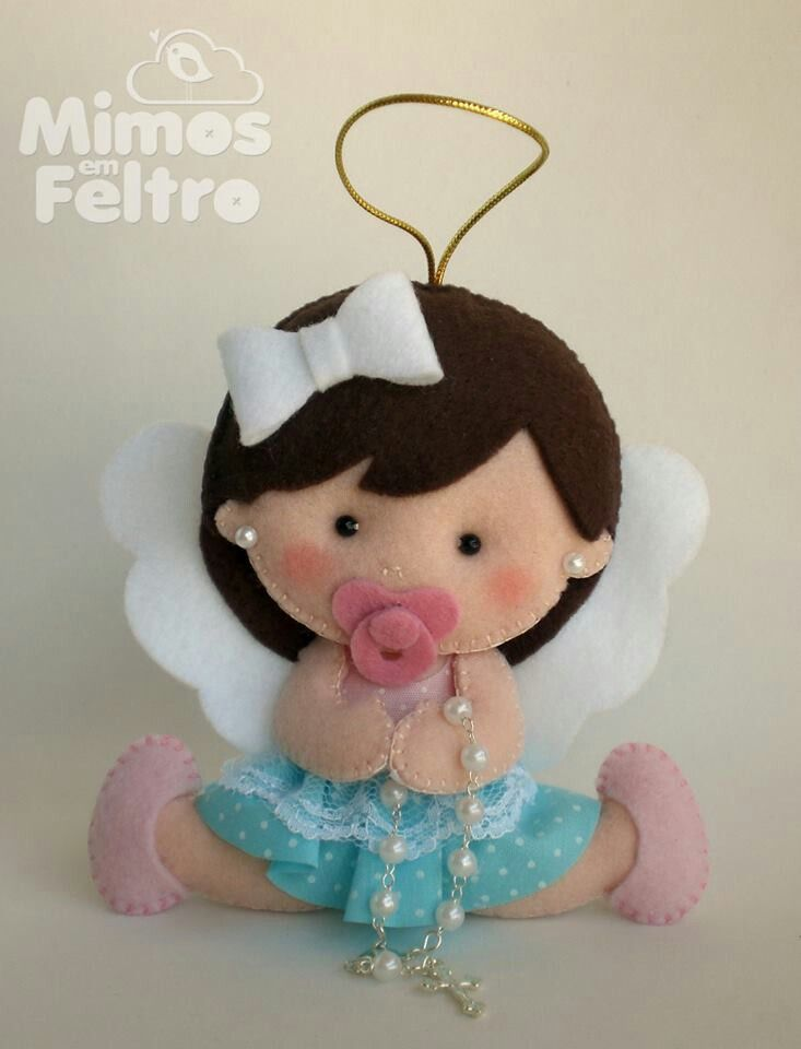 Angel felt doll with rosary.