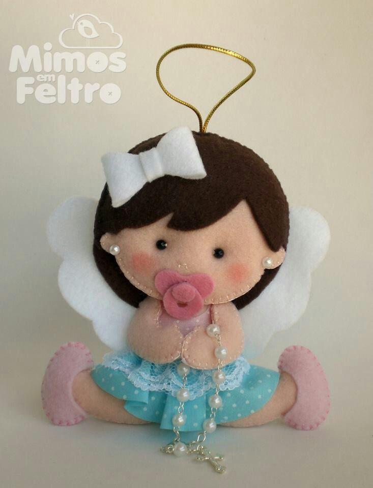 Angel felt doll with rosary.
