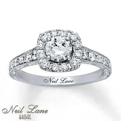 Full of show-stopping glamour, this engagement ring for her from Neil Lane Bridal® dazzles with a round diamond framed with smaller round diamonds as its centerpiece. Additional diamonds and vintage-inspired milgrain detailing decorate the band, bring the total diamond weight to 1 1/6 carats. Styled in 14K white gold, the band features Neil Lane's signature on the inside. Diamond Total Carat Weight may range from 1.145 - 1.17 carats.