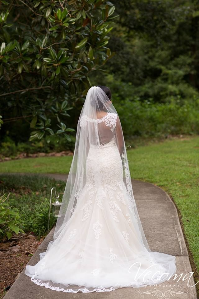 Beautiful lace gown with cathedral-length veil