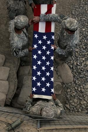 soldiers fold flag